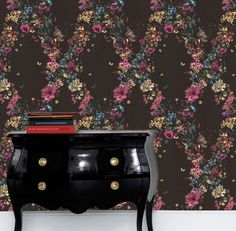 Cole and Son Fiori - Fornasetti's love of exuberant flowers is typified in Fiori taken from a 1953 design, 'Fiori nella Notte' on a chest of drawers.