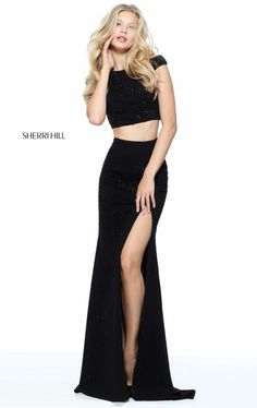 Flatter your figure in this two-piece set gown, Sherri Hill 50866. The crop top features a bateau neckline with fitted bodice.