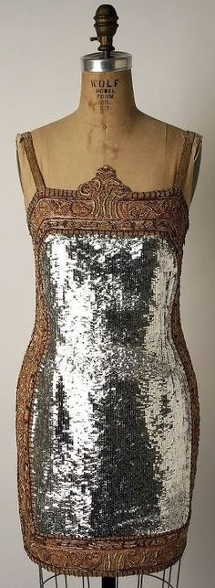 vintage 1920s flapper style with silver lame overlay…