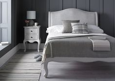 The Emily bed frame is inspired by classic French design and features subtle carving details and an attractive upholstered headboard. Finished in a warm grey lightly distressed paint finish, the Emily will create a warm and sophisticated look in your bedroom. The Emily comes complete with a traditional wooden slatted base system, and the design will work well in both modern and more classical design schemes. Please note the bedsides can be purchased separately, see related furniture tab for…