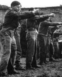 1944 Jedburgh firearms training at Milton Hall, Peterborough, Cambridgeshire, England, on the small arms range with.45 automatic pistols