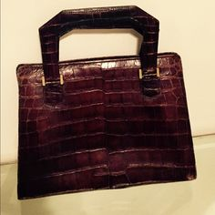 """Hermes Vintage """"Pullman"""" Handbag, mid-20th Century Hermes Vintage """"Pullman"""" Handbag, mid-20th Century. dark brown crocodile.The bag closes with a pressure clasp. Although it has faded you can still see that it is embossed Hermes - Paris.  There is wear on the bag please see photos.  Please see photos for measurements. Please ask any questions you may have before purchasing Please see my other great designer listings Hermes Bags"""