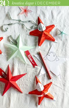 DIY Santa stars. Fold them for Christmas dinner place cards or decorating gifts and Christmas mantles.