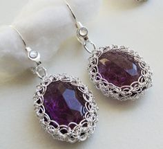 Looooove this....Sterling silver purple crystal earrings. $35.00, via Etsy.