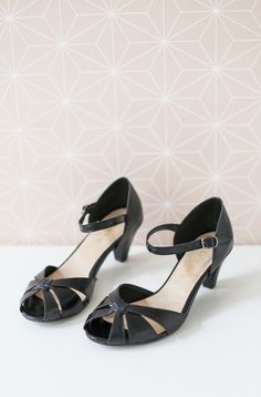 ShlomitOfir - Vera Heels in Black. Open toe sandals with a thin ankle strap and low heels
