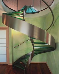 Glass and steel helix spiral staircase