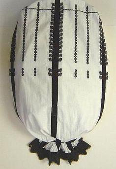 Romanian blouse   Sleeve embroidery on Cămaşă cu umeraş şi şire, Sibiu Transylvania Punctul 'Ciocănele'  - black rows of embroidery down sleeve which give the appearance of braid. Black crotched lace on lower edge of wrist flounce