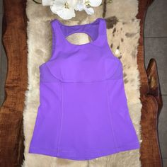 LULULEMON OPEN BACK TANK GREAT CONDITION Lululemon Swank Tank in purple. A light support yoga tank designed with high coverage in the front and a breathable open back to help keep you cool and covered in Down Dog. Designed with self bra  lululemon athletica Tops Tank Tops
