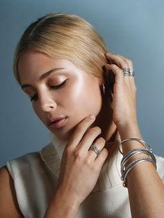Stack up on timeless shiny sterling silver bracelets and rings for an elegant everyday look. Click the image for more classic and sophisticated looks. #PANDORAmagazine