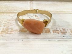 Goldtone Wire-Wrapped Coral Stone Wavy Bangle