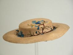 1850 - 1860 Woman's hat.  Straw with woolen embroidery.  Snowshill Manor © National Trust / Richard Blakey
