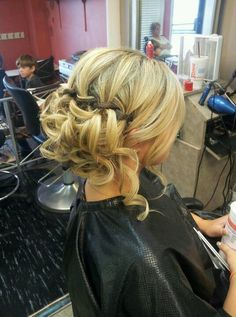 Do a low side chignon on bottom, take random pieces from both sides and pin, waterfall braid on top, curl sections and done!