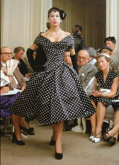 Dior house model Victoire wearing a dress called 'Porto Rico' from the autumn/winter collection, Paris, 1954. Photo by Mark Shaw.