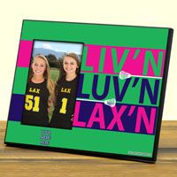 """Our 8"""" X 10"""" lacrosse frame features our Livn Luvn Laxn design and a 4"""" X 6"""" opening to fit a photo of your choice. Immortalize that special moment, game, or season for the lacrosse player in your life."""