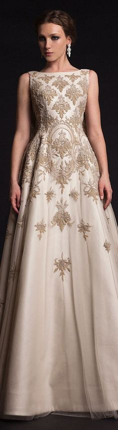 A gorgeous silky beige gown http://www.enchantedempire.com.au/black-white-gold-colour-inspiration/#more-9083