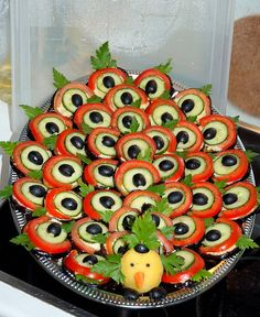 I might be going off the deep end but this is cute! Peacock design appetizer -- how unique!