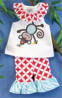This 2 piece set from Mud Pie includes a cotton tunic with a whimsical dimensional monkey applique featuring curly grosgrain ribbon, trendy geometric red print collar and a racer bow back. Cotton spandex blend capri leggings with matching patterns complete this fun set! Available in 0-6. 9-12, 12-18 and 2T/3T. Part of Mud Pie's Safari baby collection: Jungle animals are hanging around on bright bold patterns in our Safari collection. Paired with unique accessories, the Safari collection is b...
