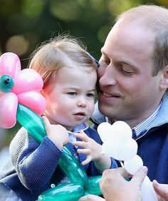 Prince William, Duke of Cambridge and Princess Charlotte of Cambridge at a children's party for Military families during the Royal Tour of Canada on September 29, 2016 in Carcross, Canada.