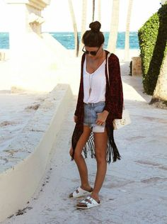 White tank, light wash jean shorts, maroon long knit sweater, and white Birkenstocks: this boho look is perfect for summer and totally chic
