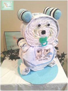 The Teddy Bear diaper cake comes complete with approximately 53 diapers, two (2) receiving blankets, 3 pairs of baby socks, a baby bib, baby washcloth and pacifier.  We can design for a baby boy or girl!
