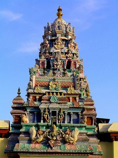 Malaysia - Penang Island  Sri Mariamman Hindu Temple in the south Indian Dravidian style. Built 1883. The gopuram (tower) features Hindu deities, soldiers & floral decorations.