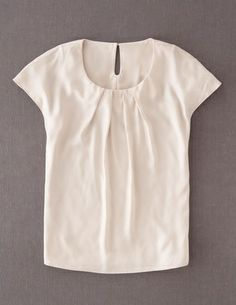 Mom has a top similar to this one, but in blue. The sleeves may be a little longer, but this shape of top looks good on her.