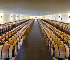 1926   The decision to bottle the wine at the château means more storage space is needed there. The spectacular 100-metre-long Grand Chai (Great Barrel Hall), designed by the architect Charles Siclis, is built in 1926.