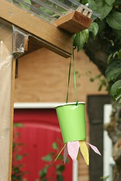 Butterfly Feeder Craft- cute idea.  Maybe use the plastic cups for something a bit more durable?  Petals from ribbon instead of tissue paper?