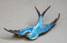 Large Victorian Enamel Swallow Brooch.     Swallows mate for life, a sweet token of love. $85.00, via TheHiddenChamber, Etsy.
