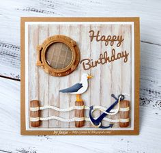 Janja's card using Porthole, Pelican, Rope corner, Seagull, Anchor, Happy and Anchor dies