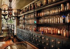 Drawers, glass bottles, wood work-a cabinet of curiosities or wunderkammer or apothecary Apothecary Shoppe, Apothecary Cabinet, Apothecary Bottles, Apothecary Decor, Antique Bottles, Vintage Bottles, Vintage Perfume, Antique Glass, Liquor Cabinet