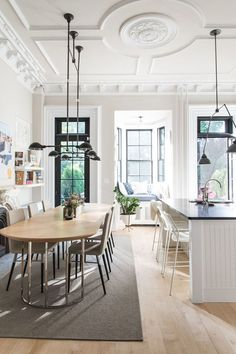 beautiful neutrals in the dining room and kitchen with modern furnishings and industrial lighting | coco+kelley-brooklyn brownstone home tour
