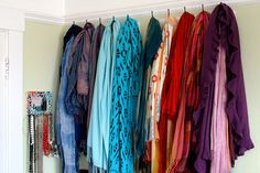 What to do with an extensive scarf collection How to organize & store a large scarf collection. Coat hooks from ikea. When arranged by color the Scarf Organization, Organization Ideas, Storage Ideas, Scarf Storage, Boutique Interior, Walk In Wardrobe, Large Scarf, Coat Hooks, Wardrobes