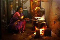 Tamil girl, cooking on the festival day - Painting by S. Elayaraja
