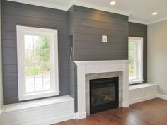 Cozy living area with custom built-ins. #fireplace #shiplap #custombuiltins #builtins