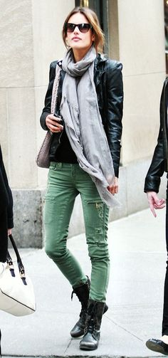 Distressed green skinny jeans, grey scarf, biker's jacket with epaules and lace-up boots. Nice.