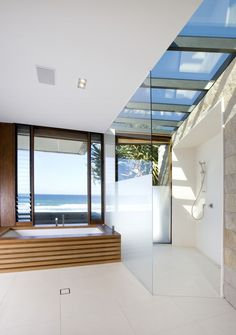 Wow! Disregarding (if you can) the view from the tub, take a look at the shower.  The skylight, the textural versus smooth walls, the open plan, the frosted glass, the light, the air. Love it. Albatross / BGD Architects