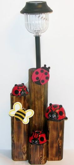 3 Adorable handpainted ladybugs with painted wood insects.  The post is a finished landscape timber with a solar light.  27  x 10  x 5