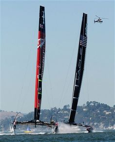 Emirates Team New Zealand (L) and Oracle Team USA compete in the first race of the 34th America's Cup in San Francisco