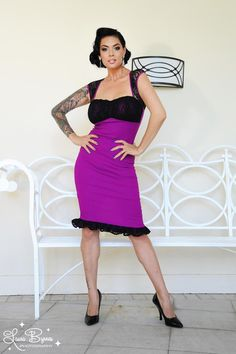 """Micheline Dress in Baton Rouge Bengaline with Black Lace - New jewel tones for our popular Micheline Dress!  Features include a fitted, structured """"wiggle"""" silhouette, cap sleeves, gathered stretch lace covered bodice, and a ruffle black lace hem. The gathers at the bust create the illusion of bigger chi-chis, something Laura, PUG's Supreme Overlord, appreciates very much. A 10"""" back slit creates ease of movement. And like all Pinup Couture styles, it's surprisingly comfortable!"""