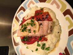 Lemon thyme salmon on a roasted red pepper on a bed of garlic mashed cauliflower. Yum!