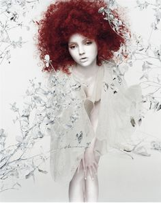 British model and actress Lily Cole is one of those rare beauties that you can easily obsess about. By overemphasize her ethereal features (porcelain skin, red hair and doll-like features) photographer Sølve Sundsbø creates an alienesque, manga looking character, innocent and yet incredible sensual.
