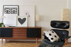There is a lot going on here that I like. | Olle Eksell print and Eames lounge.