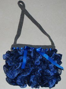 Sashay Ruffle Purse | AllFreeCrochet.com The scarves are fun and easy to make.  This would be beatiful as a prom or wedding purse.