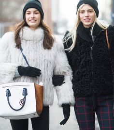 Model Ophelie Guillermand carrying a Michael Kors Sophie handbag at New York Fashion Week. February 2014