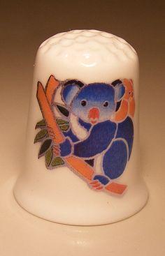 Koala bear porcelain thimble These are for sale by https://www.speelgoedenverzamelshop.nl/vingerhoedjes/dieren/koala_beer_bedrukt_op_een_porselein_vingerhoedje_(hmkoa03).html