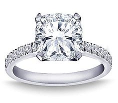 I kind of like the cushion cut. As long as there's not a ring of diamonds around the center diamond. 1 1/2 Carat Cushion Cut Diamond Engagement Ring.