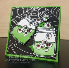 Spilling eyeballs Halloween card featuring Jar of Haunts stamp set from Stampin' UP!. Spider web paper from Halloween Night DSP pack. by Patty Bennett