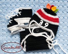 MUST PURCHASE CHICAGO BLACKHAWKS Hockey Helmet Hat, Diaper Cover and Skates with Players Number and Feathers in NHL Colors Black Red and White via Etsy and  Grandmabilt