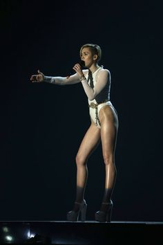 Miley Cyrus took to the stage in a revealing bodysuit to perform her single 'Wrecking Ball'. #Hollywood #Fashion #Style #Beauty #MTVEMA